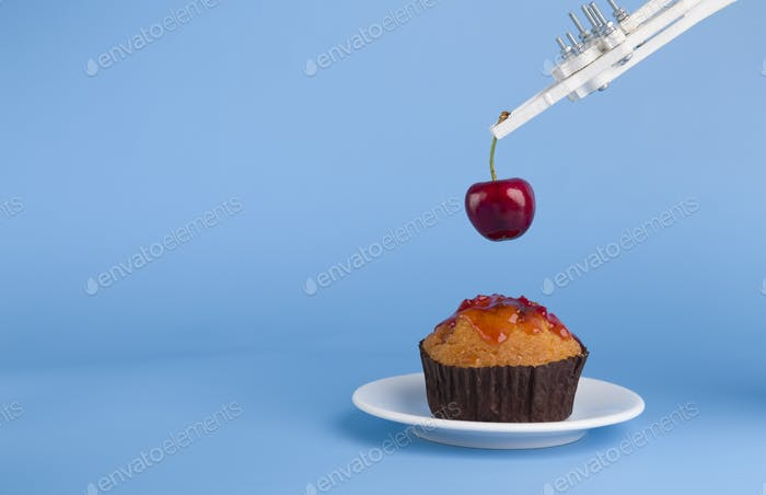 Robot preparing sweet cupcake with cherry, blue background