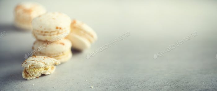 Vanilla caramel macarons, copy space. Holidays and celebrations concept. Sweet gift for woman, girl