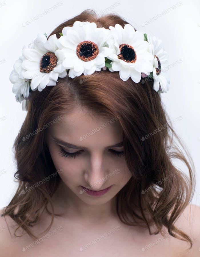 Young attractive woman with wreath on head