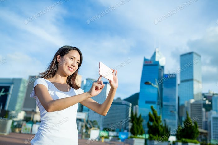 Woman taking picture on cellphone