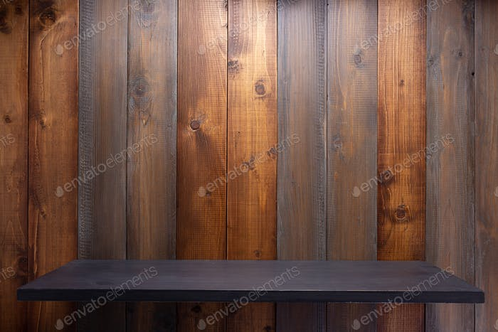 wooden shelf at board plank background wall