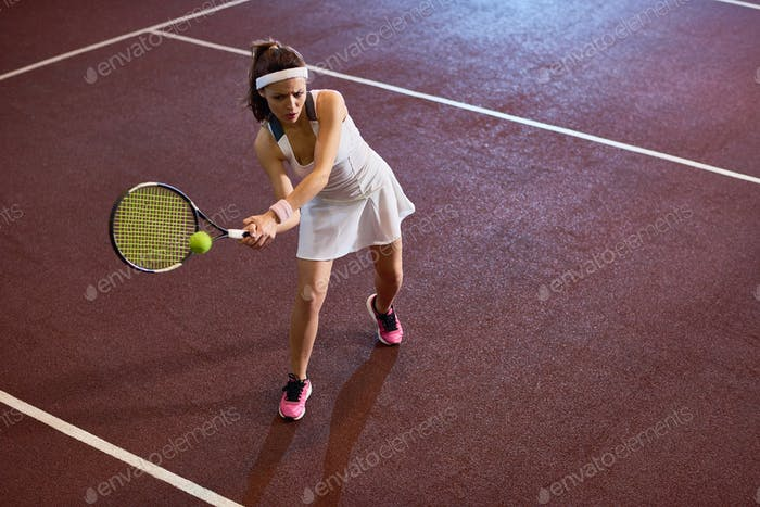 Female Tennis Player Practicing in Court