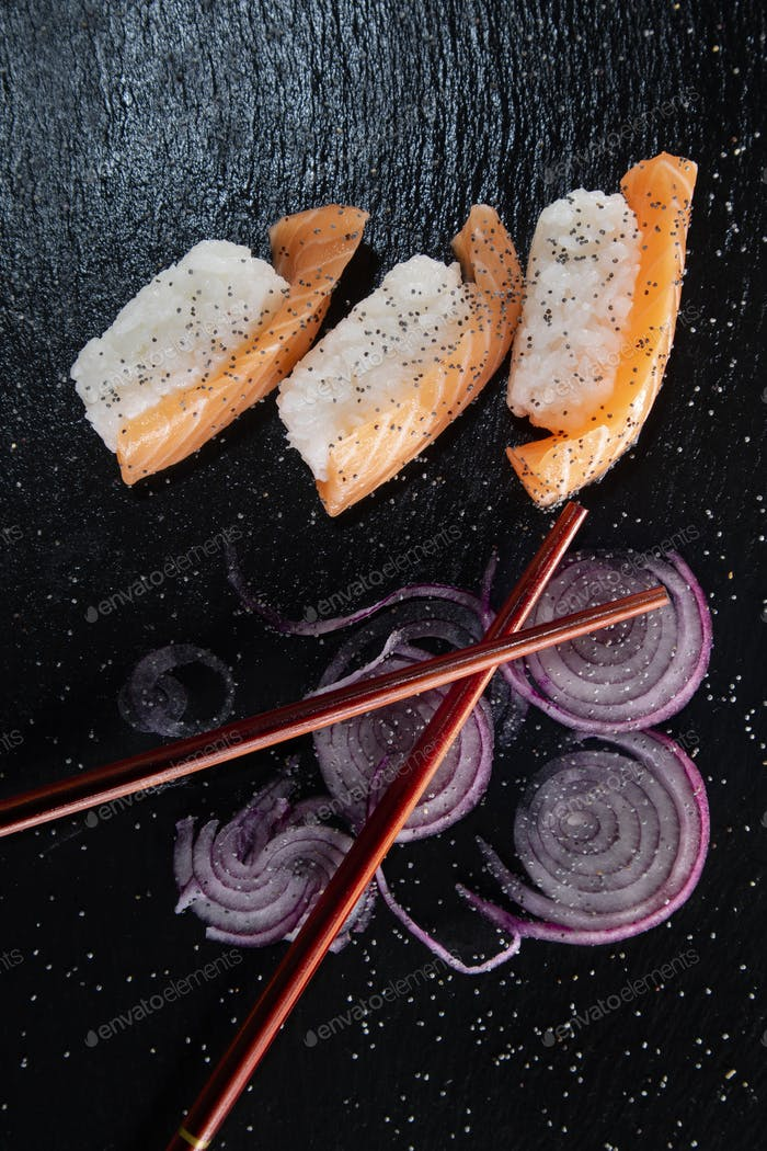 Sushi with red onion garnish