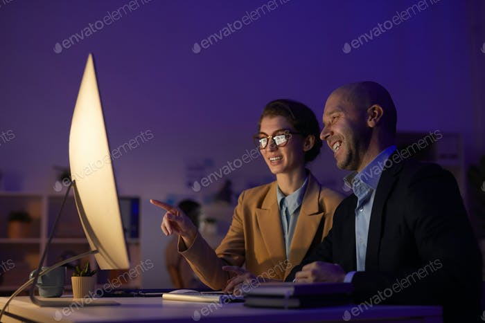 Man And Woman Co-working On Project