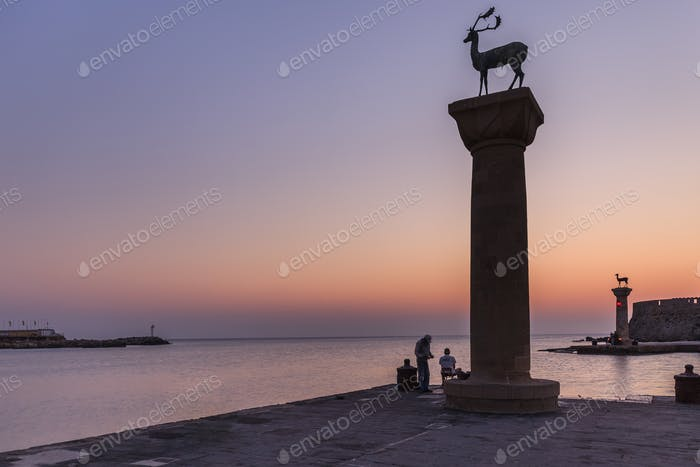sunrise in Mandraki harbor. Rhodes, Greece