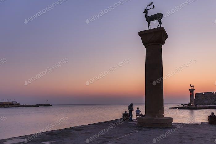 sunrise in Mandraki harbor. Rhodes, Greece