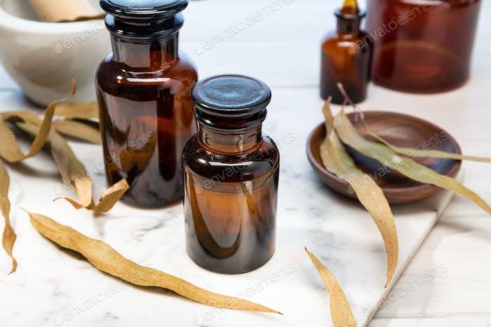 Eucalyptus essential oil on vintage amber bottle