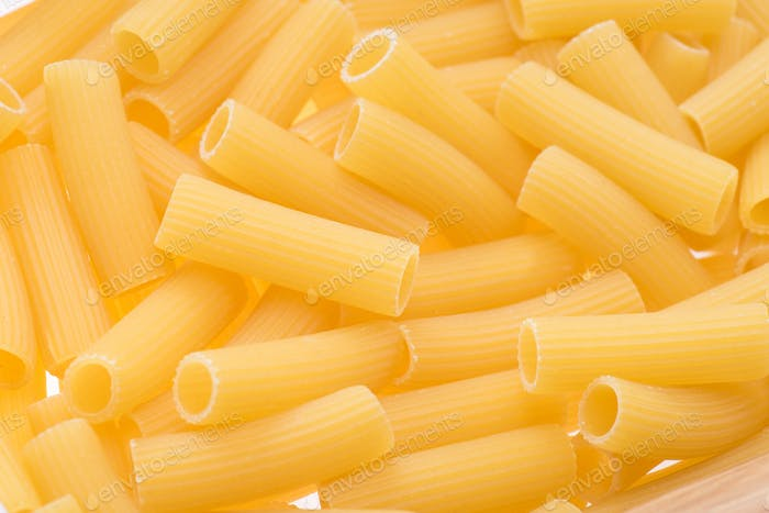 close up of small raw macaroni for making pasta