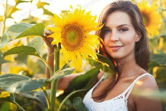 Portrait of happy woman in sunflower fields