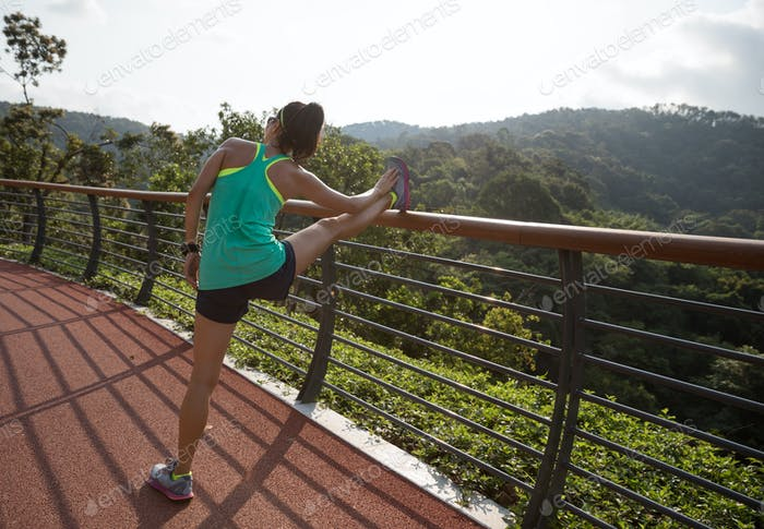 Runner stretching in the park