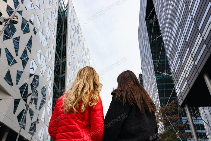 Two Young Anonymous Female Friends From Behind In The City