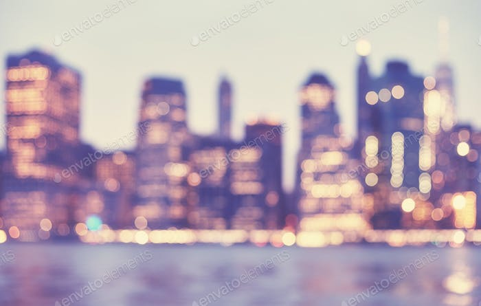 Blurred vintage toned picture of Manhattan skyline at night, NYC