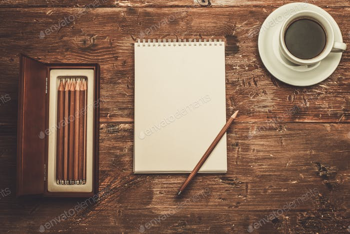 Luxurious drawing tools on a wooden table
