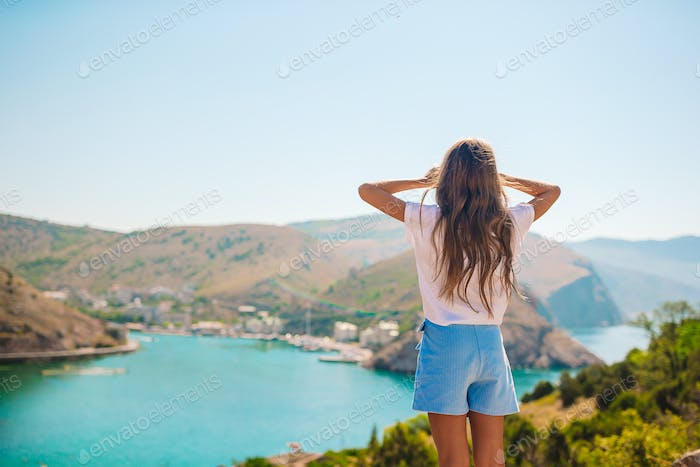 Beautiful girl with overlooking the bay
