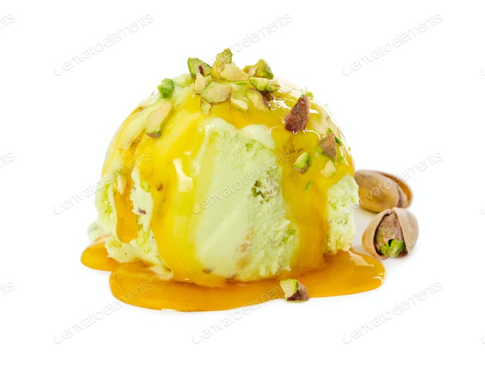 Ball pistachio ice cream with pistachios and caramel syrup isola