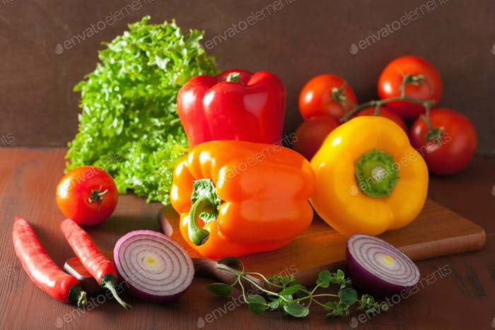 healthy vegetables pepper tomato salad onion on rustic backgroun
