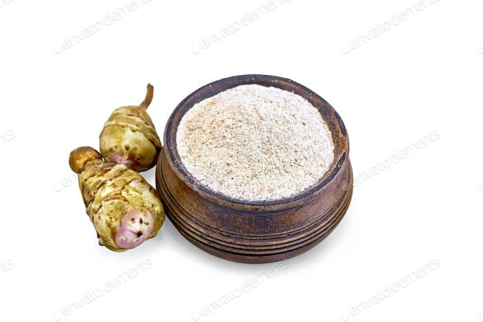 Flour of Jerusalem artichoke in bowl with vegetables