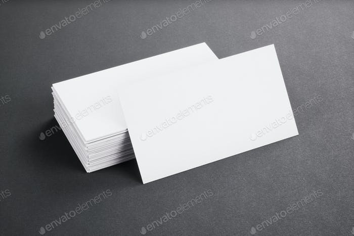 Blank template white Business Cards on black background. 3D rendering