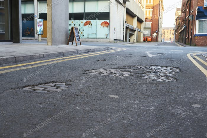 Manchester, UK - 10 May 2017: Close Up Of Potholes In City Road Surface