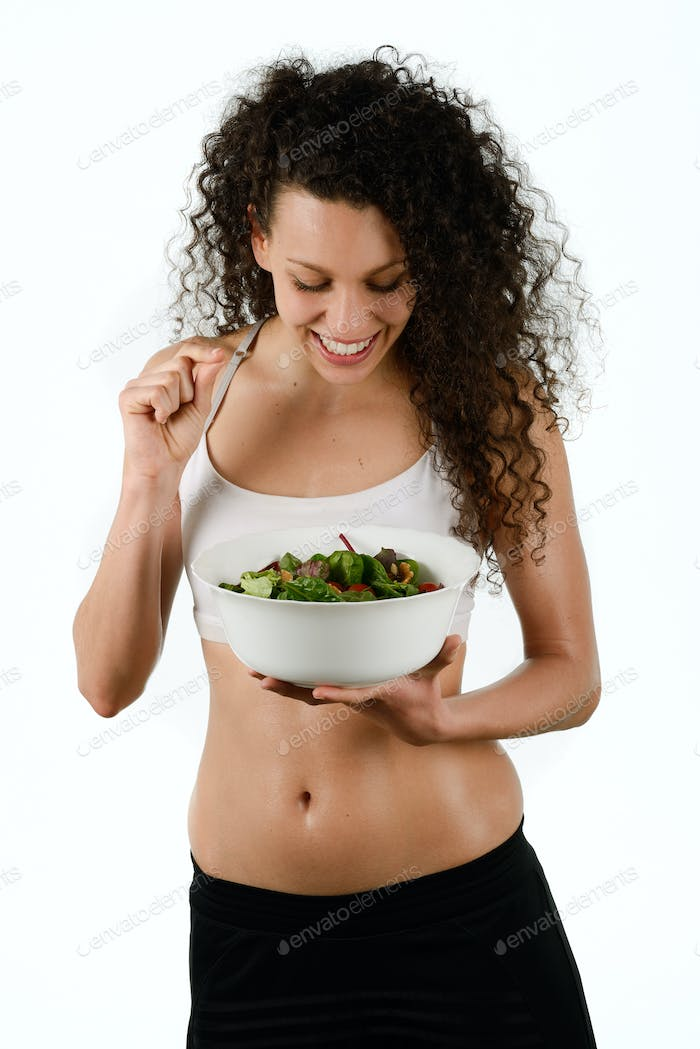 Beautiful young mixed woman with salad, isolated on white