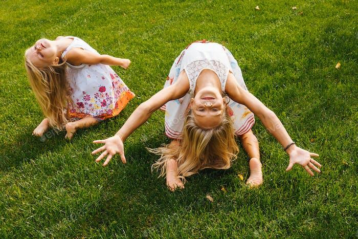 Little girls having fun on grass.