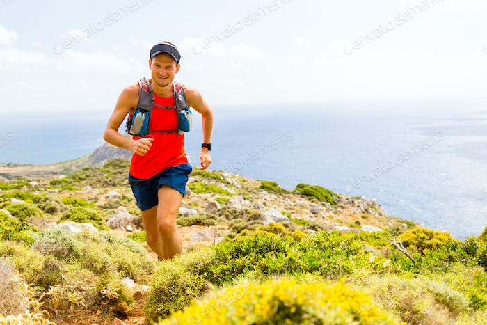 Mountain running man in inspirational landscape