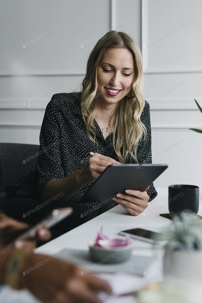 Professional woman using a tablet