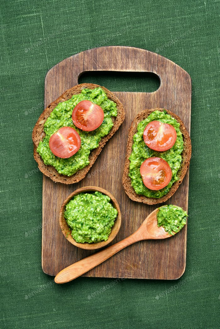 Pesto sauce and tomatoes on bread