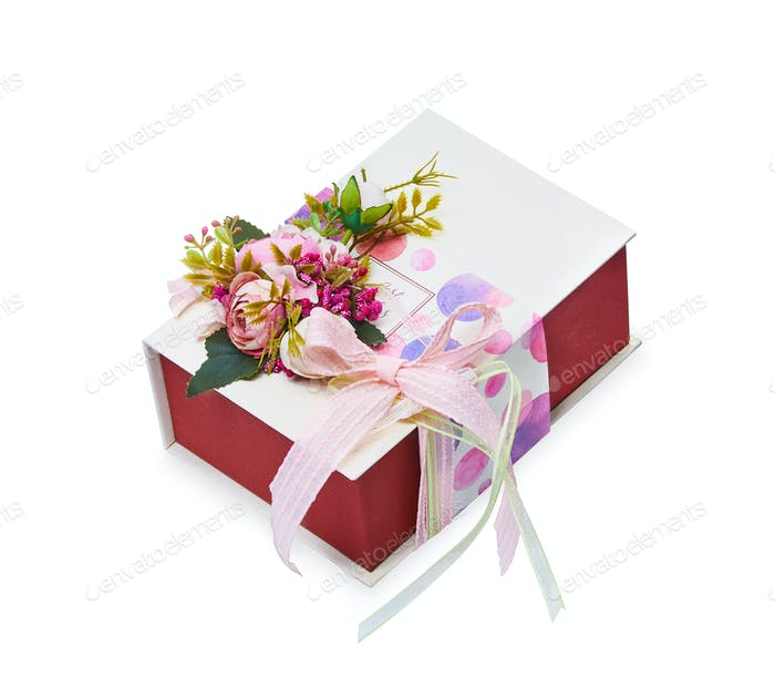 Flower arrangement and gift box on a white background