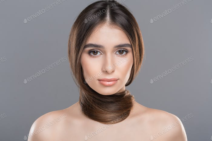 Young woman with hair around neck as scarf