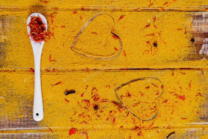 Heart of spices and seasonings. White spoon