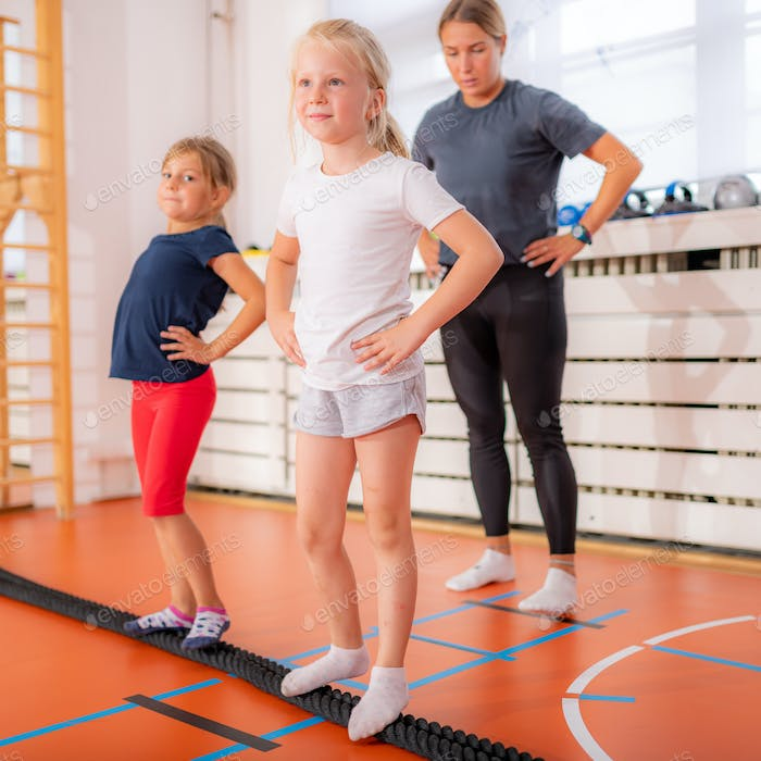 Corrective exercises for children, feet and ankle stabilization, balance improvement