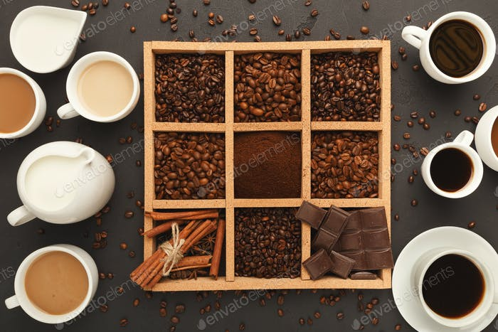 Top view on coffee beans in frame and full cups, background with copy space