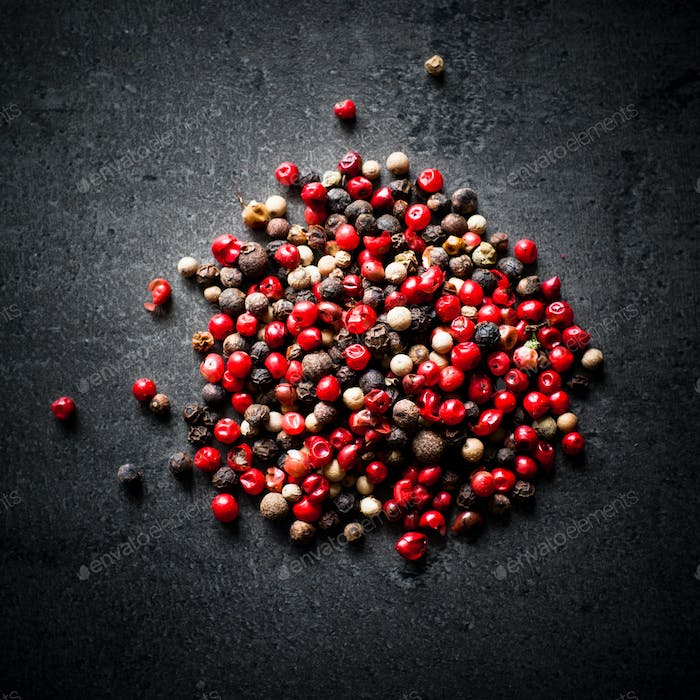 Peppercorns on a dark background