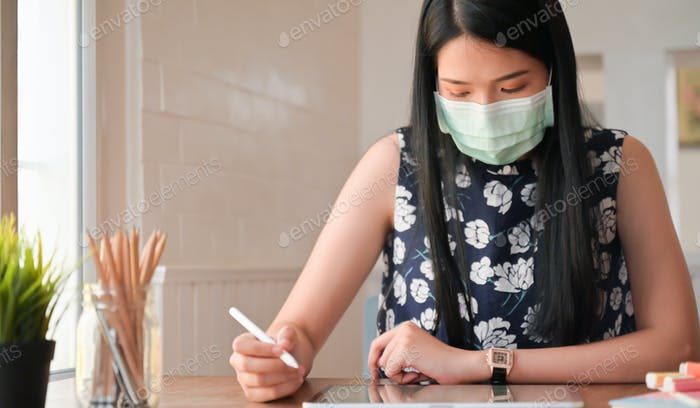 Young women and tablet working at home.She is protected from the coronavirus outbreak.