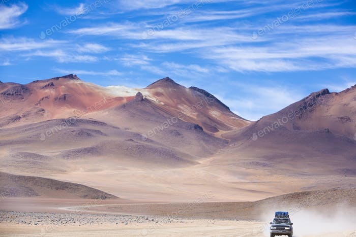 Off-road vehicle driving in the Atacama desert, Bolivia