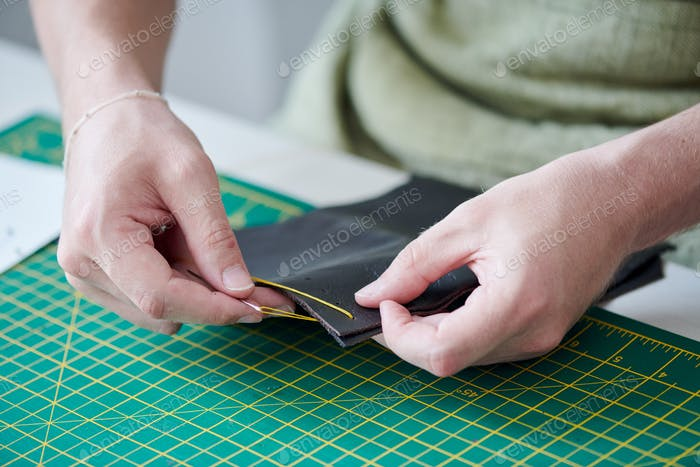 Sewing leather goods