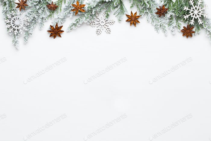 Christmas white Fir tree branches with stars decorations.