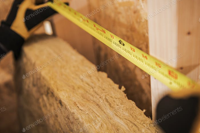 Carpenter Measuring Area With Tape Measure.