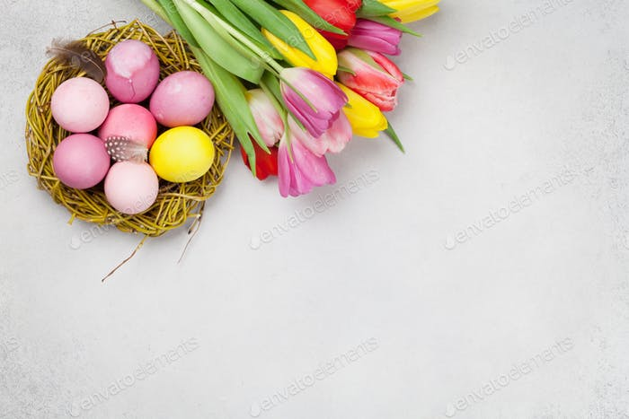 Easter greeting card with eggs and tulips