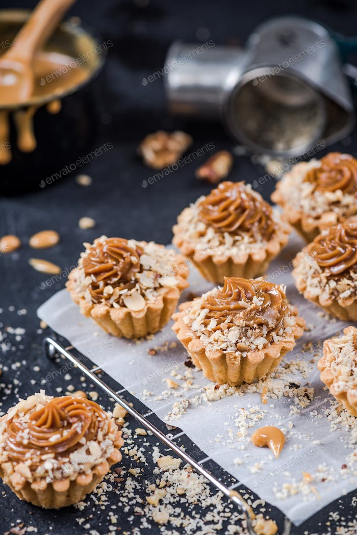 Making omemade caramel cupcakes with walnuts