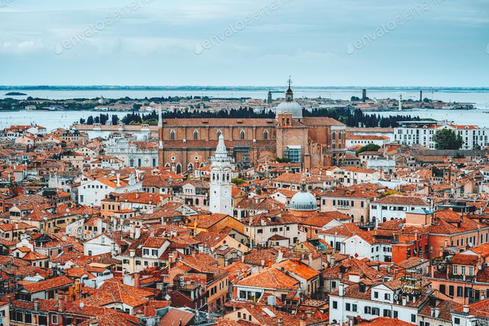 Panoramic view over rooftop of Venice, Italy. Traditional old houses with orange tiles
