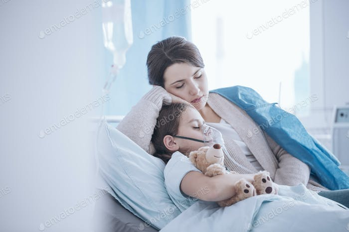 Mother taking care of sick daughter with oxygen mask and teddy b