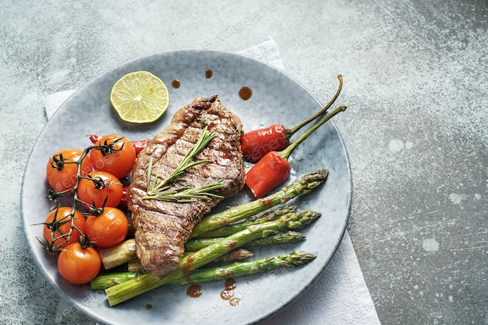 Beef steak with asparagus and cherry tomato