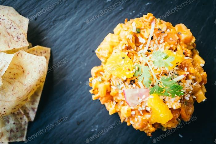 Raw fresh salmon meat tartare in black plate