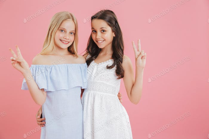 Image of two beautiful girls 8-10 years old wearing dresses smil