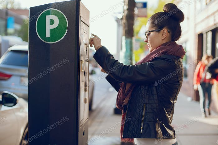 woman pays for Parking