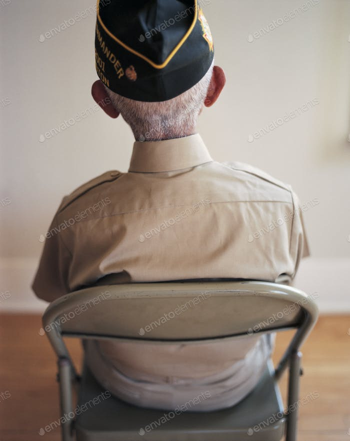 Portrait of seated elderly WWII veteran