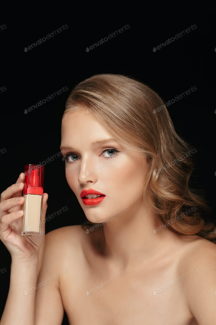 Portrait of young attractive woman with wavy hair and red lips h