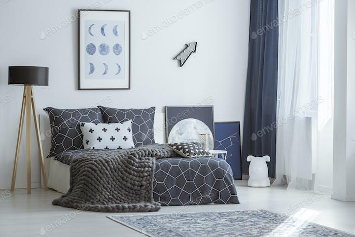 Arrow in bright bedroom interior